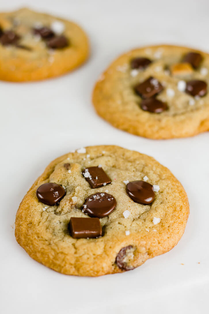 Peanut butter and Nutella stuffed cookies sprinkled with flaky sea salt - Flour Covered Apron