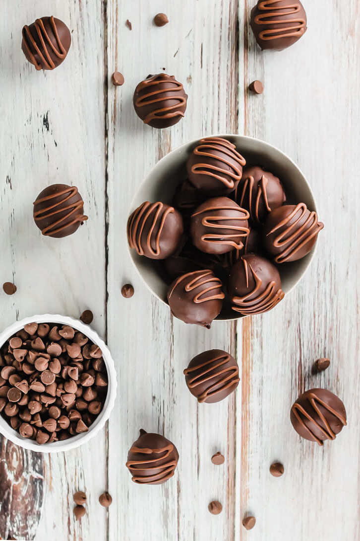 Chocolate chip cookie dough truffles drizzled with milk chocolate - Flour Covered Apron