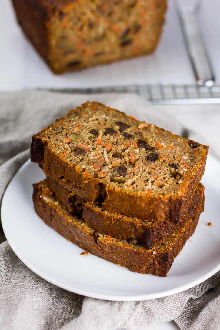 Slices of whole wheat carrot bread - a lightened up quick bread recipe that's perfect for breakfast, or a snack.
