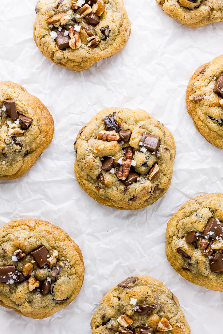 Chocolate chunks, chopped pecans, and flaky sea salt are pressed into the top of these jumbo cherry chocolate chip pecan cookies