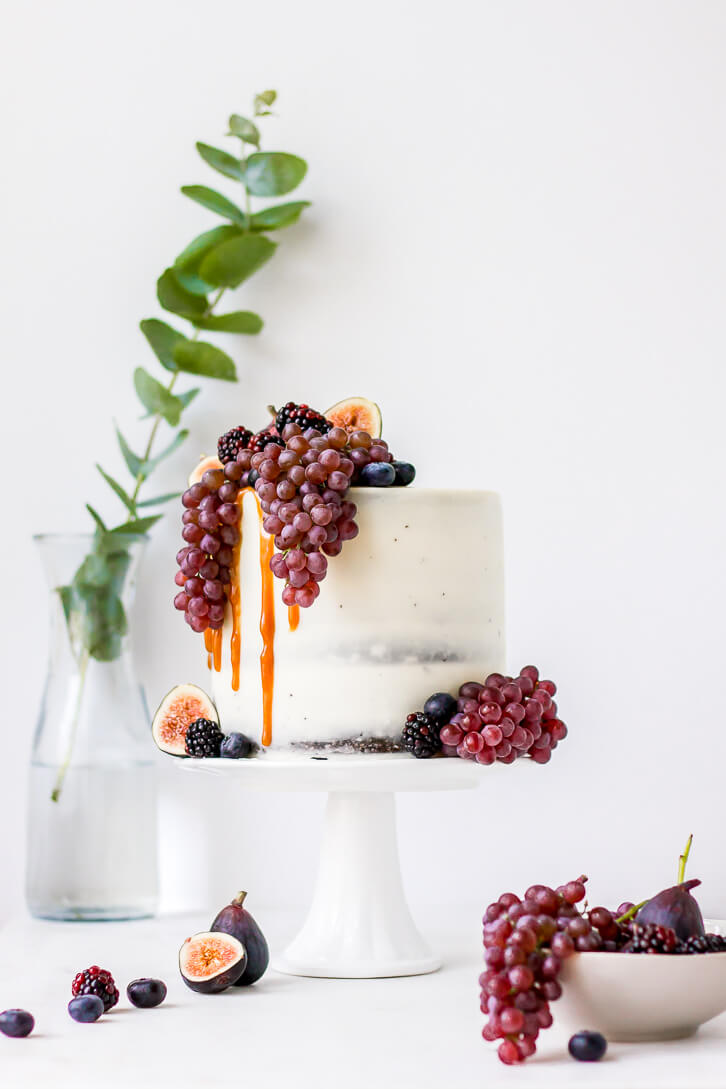 A six layer dark chocolate cake filled with dark chocolate ganache and salted caramel, and frosted with vanilla Swiss meringue buttercream. Decorated with fresh figs, blueberries, and blackberries.
