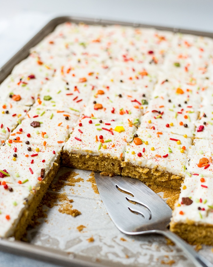 A moist sweet potato sheet cake with a layer of rich cream cheese frosting and topped with sprinkles