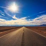 Photo of road under a clear sky
