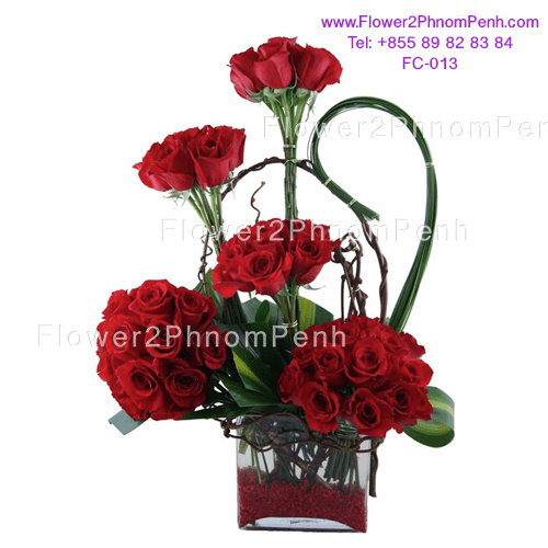 glass vase arrangement of red rose