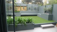 Modern small low maintenance garden fake grass grey raised ...