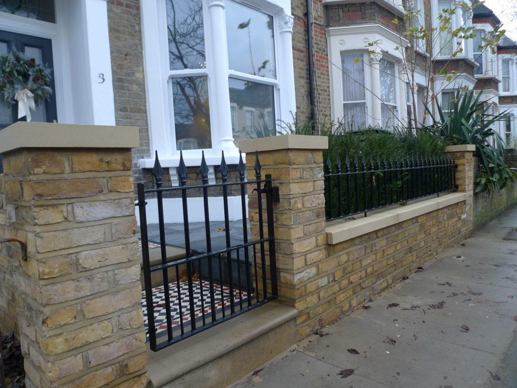 Yellow London brick wall black and white Victorian mosaic