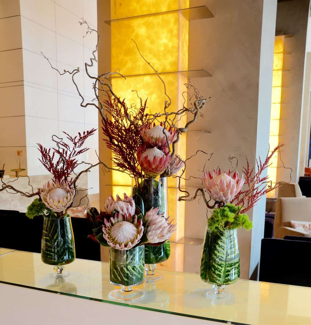 A collection of stunning protea, with bromeliad blooms and branches