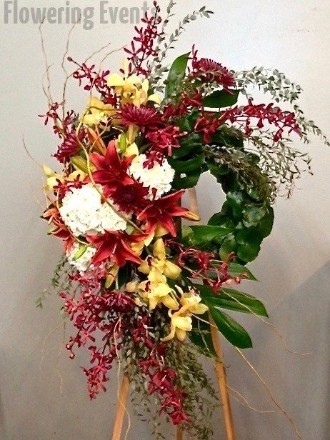 Wreath of white hydrangea orchids lilies and yellow iris