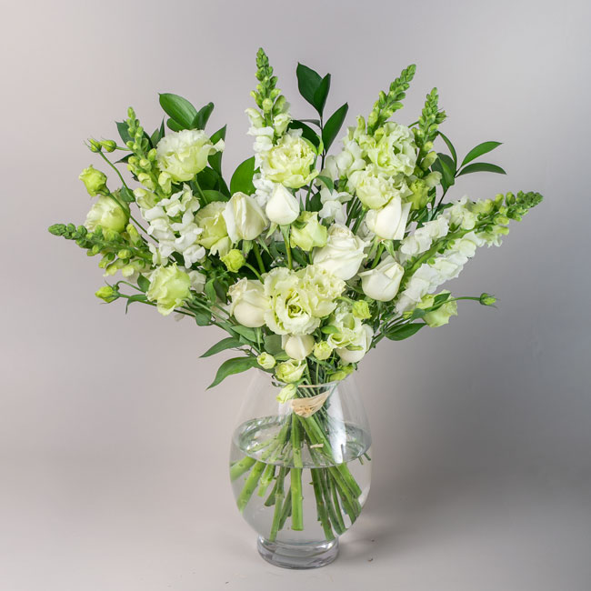 Bouquet containing white roses by Flowerist