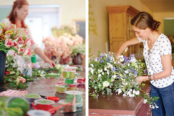 Left: Tables strewn with rolls of ribbon and buckets of flowers await workshop participants. | Right: Erin Benzakein works on creating a pleasing cascade for an arrangement.