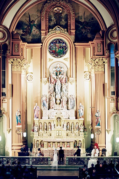 The couple celebrated a wedding Mass at the majestic baroque altar of St. Mary's Assumption Church.