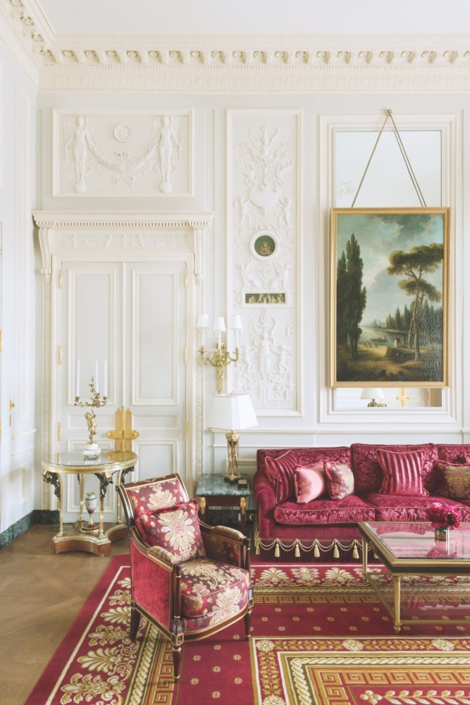 Ritz Paris suite with ornate walls and rich red upholstery with gold-toned details