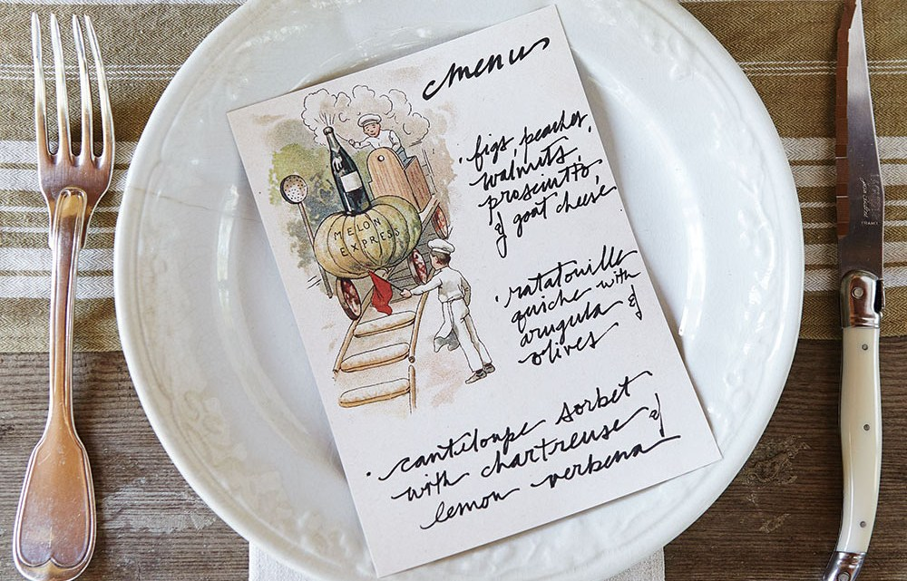 Place setting with summer menu on a plate
