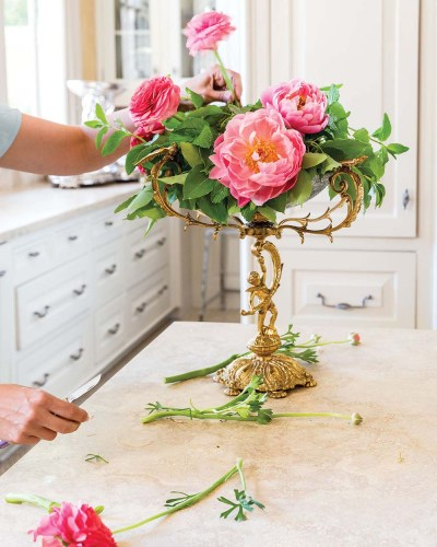 Step 5 photo: Destiny Pinson adds 'Clooney' ranunculus to the floral arrangement