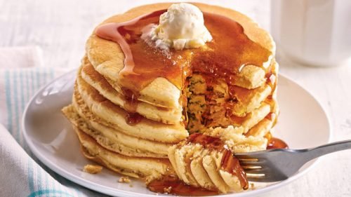 Stack of 5 pancakes with butter and syrup