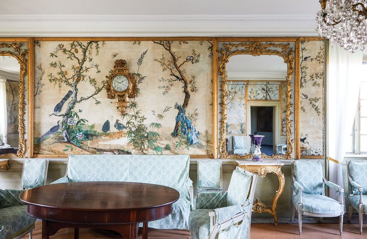 The handpainted scenic wallpaper features a landscape of peacocks and small trees.