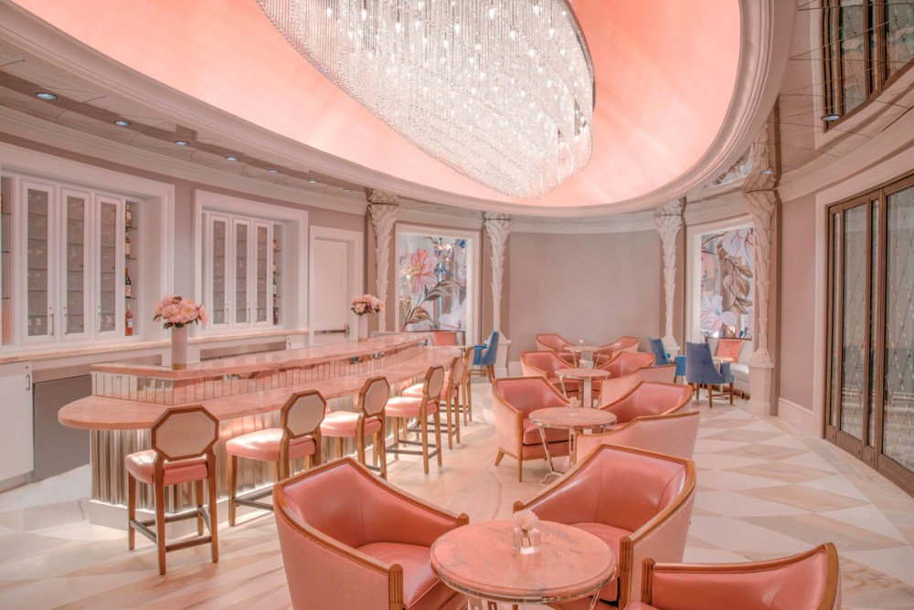 The pink, lavish interior of Camellias Bar at Hotel Bennet in Charleston, SC