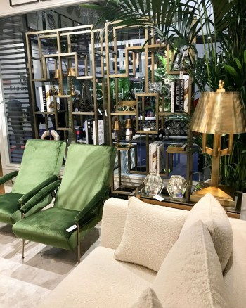 Scene from Maison & Objet 2020: two green chairs paired with a soft white sofa and gold accents
