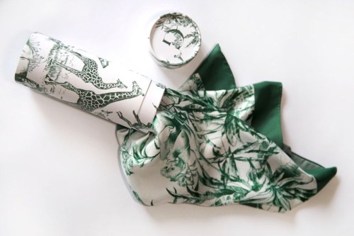 white silk scarf with a green African landscape print