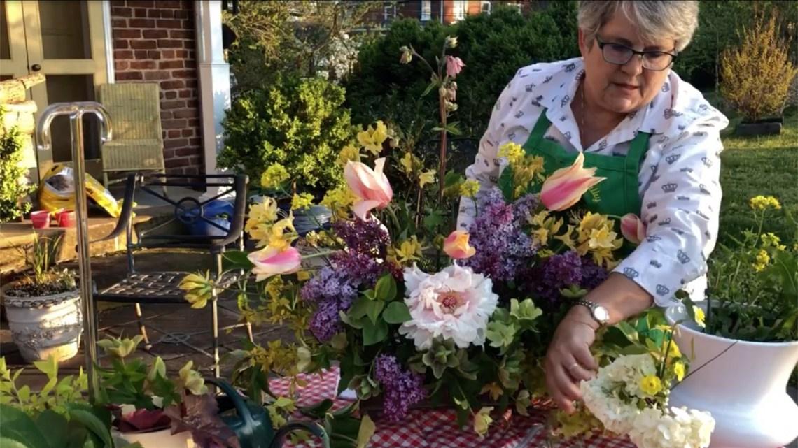 Jeanette Cadwallender of Garden Club of Virginia arranges spring flowers cut from her Fredericksburg garden