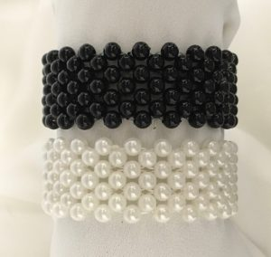 Black bead or white pearl elasticized wristbands.