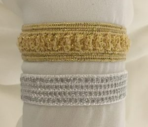 Silver or gold elasticized wrist band.
