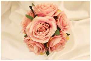 Flower girl posy with open dusty pink roses.