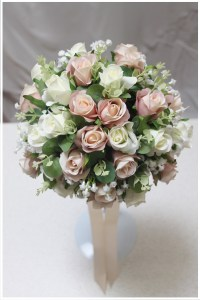 Bridal posy with mix of cream and champagne roses, gum and gyp.