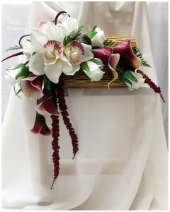 Handbag bouquet using orchids, lilies, roses and natural grasses and ferns.