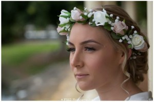 Bride with pastel rose hair circlet.