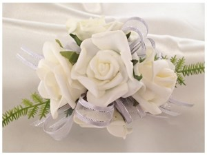 White roses with grey ribbon with silver trim