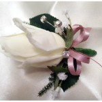 White rose buttonhole with dusty pink ribbon, baby's breath and diamantes.