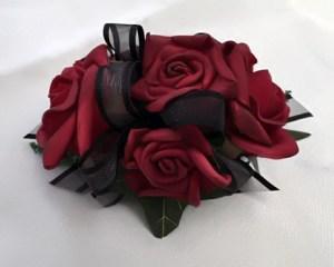 Deep red roses with black organza ribbon.