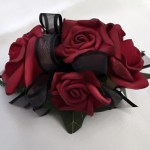 Deep red roses with black organza ribbon.