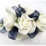 White roses with navy organza ribbon.