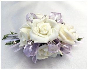 White roses, lilac organza ribbon, diamantes through out.