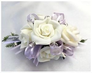 White roses, lilac organza ribbon, diamantes through out.