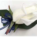 White roses button hole with navy organza ribbon/satin trim bow added.
