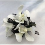 Orchids, black organza ribbon, diamantes throughout.