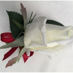 White rose button hole with deep red satin bow.