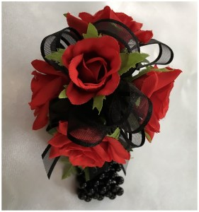 Bright red roses with black organza ribbon, black beaded wristband.