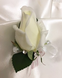 White rose buttonhole with pale pink organza bow, baby's breath, diamantes.