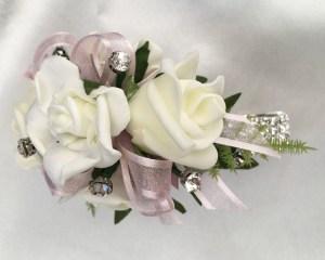 White roses, pale pink organza ribbon, diamante wristband, added diamantes.