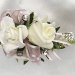 White roses, pale pink organza ribbon, diamante wristband, added diamantes.
