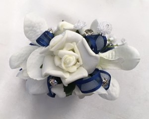 White roses and orchid mix, navy organza ribbon, added diamantes.
