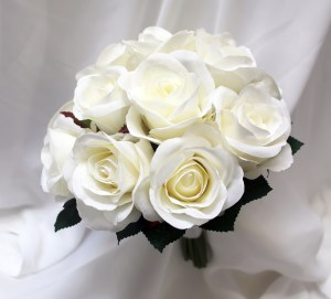 Natural white semi open roses in a posy bouquet.