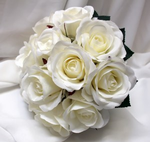 Natural white semi open roses in natural stem posy.