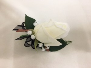 White rose button hole, black organza ribbon bow, baby's breath.