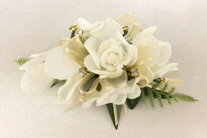 Rose and orchid mixed corsage with diamantes and gold organza ribbon.