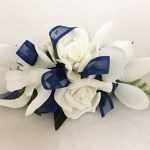 Orchid and rose mix corsage with navy organza and satin trim ribbon.